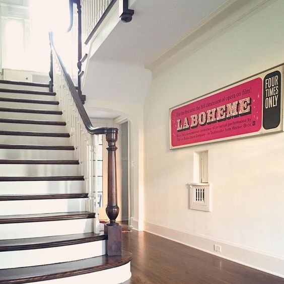 Antique opera sign makes a statement in this grand foyer kellyelko.com
