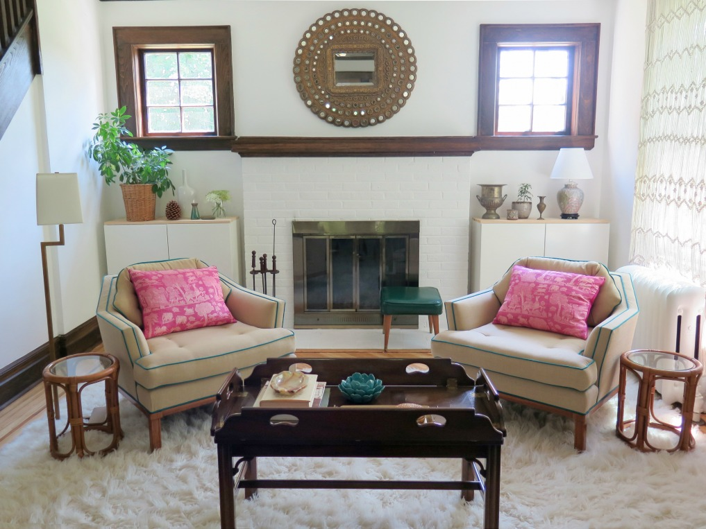 Symmetry - love the matching club chairs in this boho chic living room