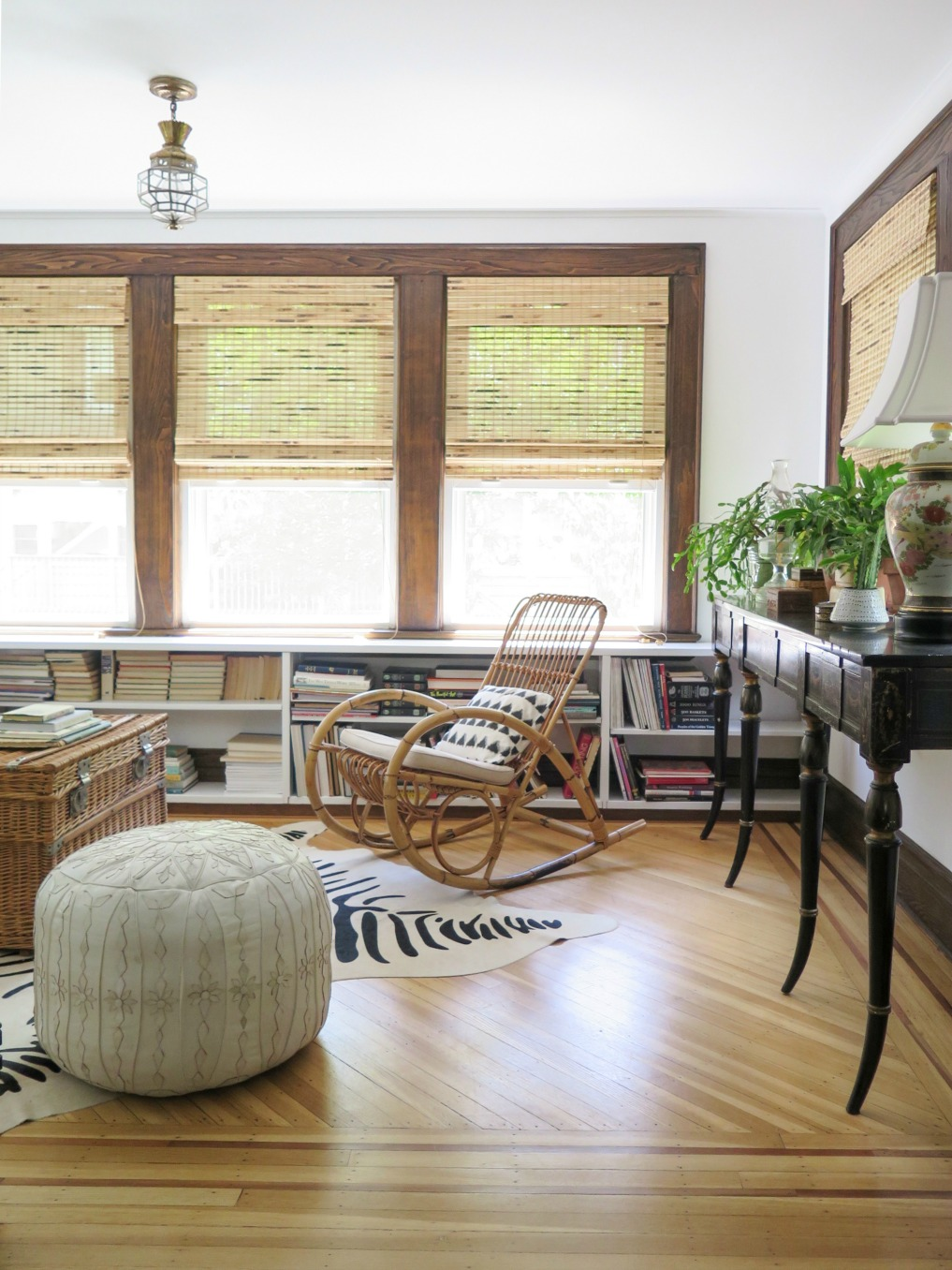 Boho home tour - love the rattan rocking chair and leather pouf in this 1920's home