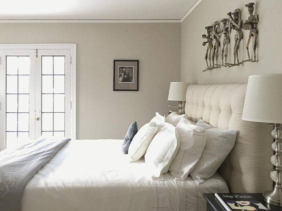 Love this neutral bedroom with tufted headboard and unique art kellyelko.com