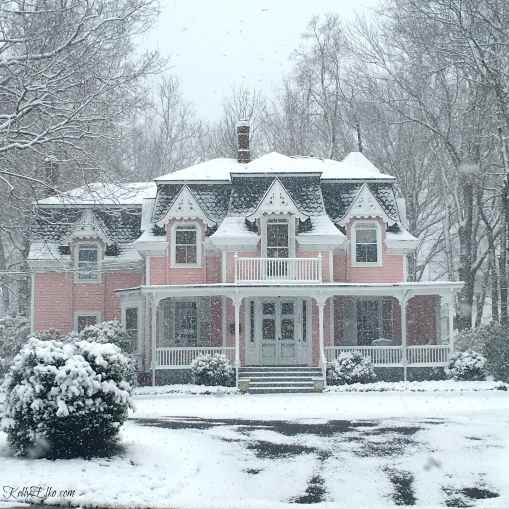 Beautiful old Victorian home in pink! Love the architecture and details kellyelko.com #victorian #oldhomes #oldhouses #curbappeal #pinkhouse #pinkhome #winterhome #letitsnow #kellyelko
