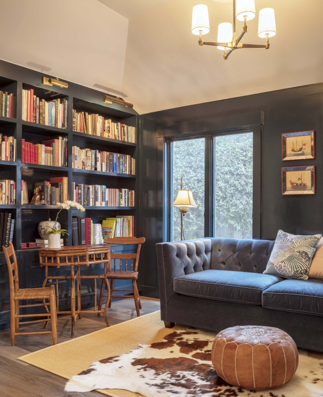 High gloss black paint creates drama when used on the walls, trim and bookcases in this study