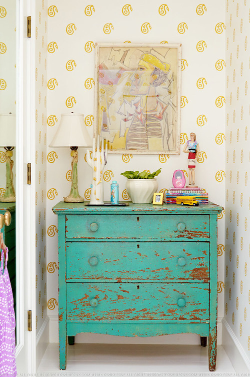 Chippy blue dresser with stenciled yellow wall