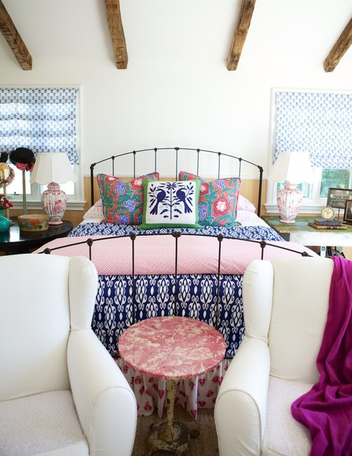 Colorful bedroom with iron bed