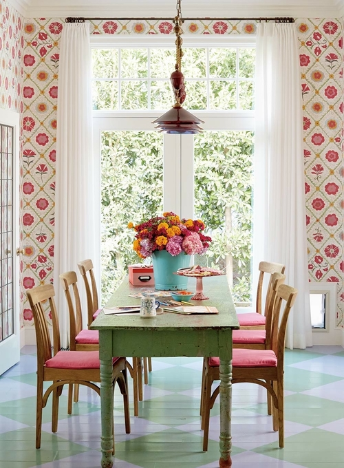 Colorful dining room in pinks and greens with floral wallpaper