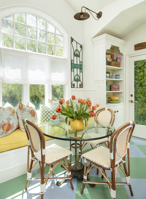 Colorful breakfast nook with built in banquette