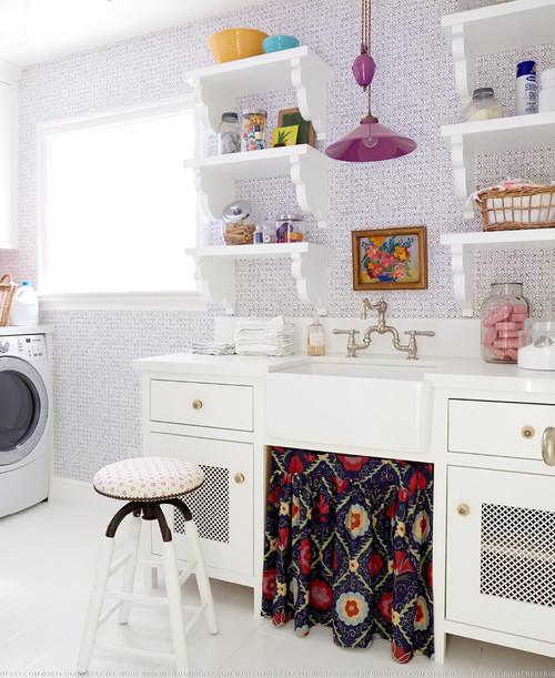 Love this purple and white laundry room with open shelves