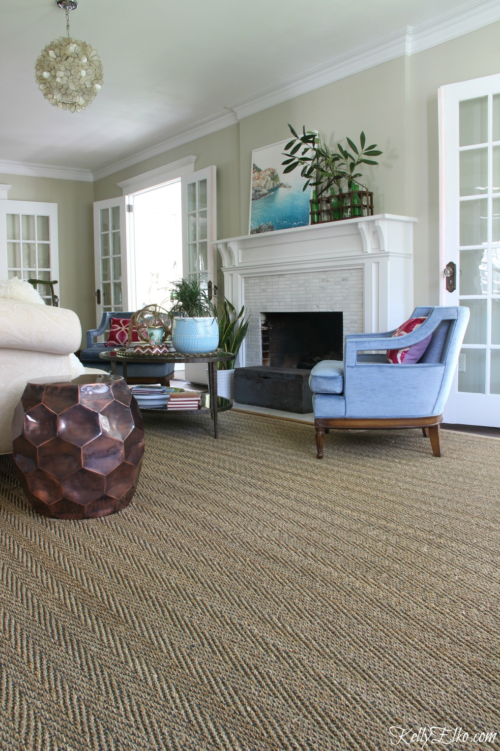 love the three sets of french doors in this beautiful living room and the neutral seagrass - Seagrass Rug