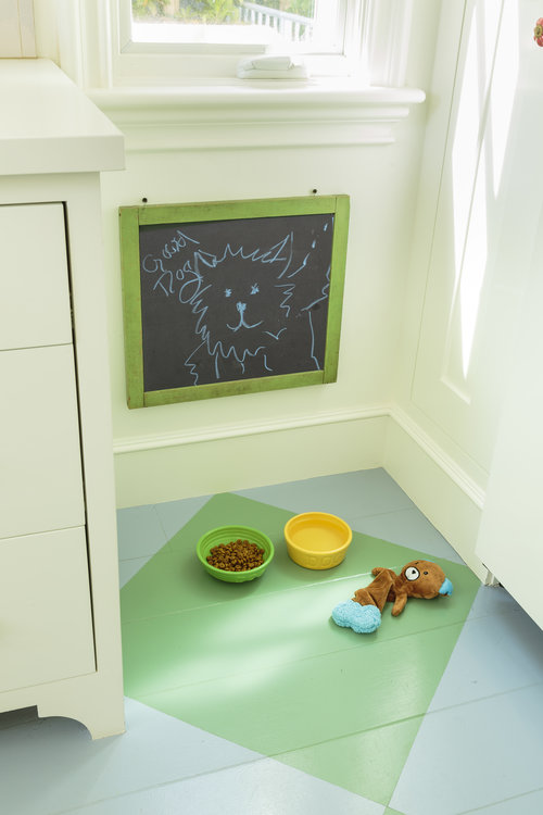 Cute little spot in the kitchen for the dog bowl