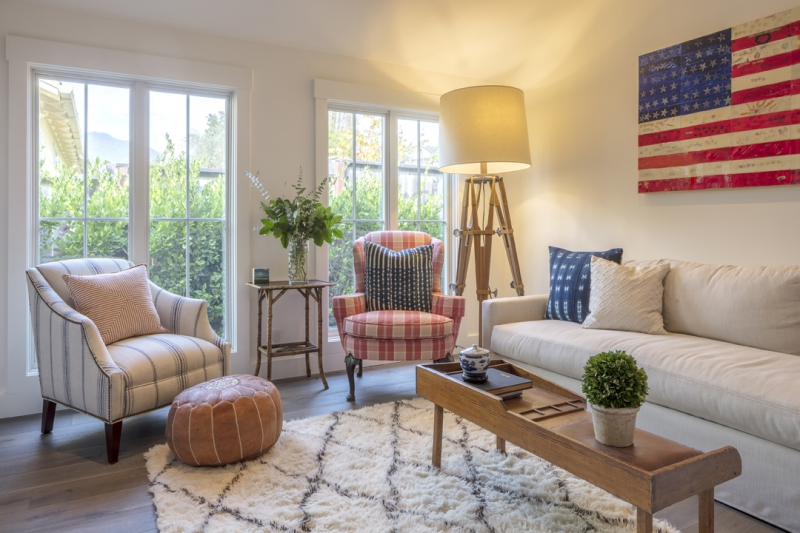 Casual family room with mismatched chairs and giant flag art