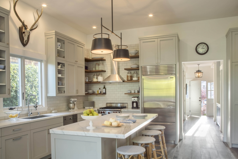 Eclectic Home Tour - Mill Valley House is a stunning renovation that includes this beautiful gray and white kitchen with open shelves and subway tile