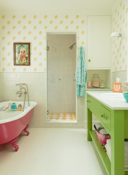 Green bathroom vanity and pink bathtub