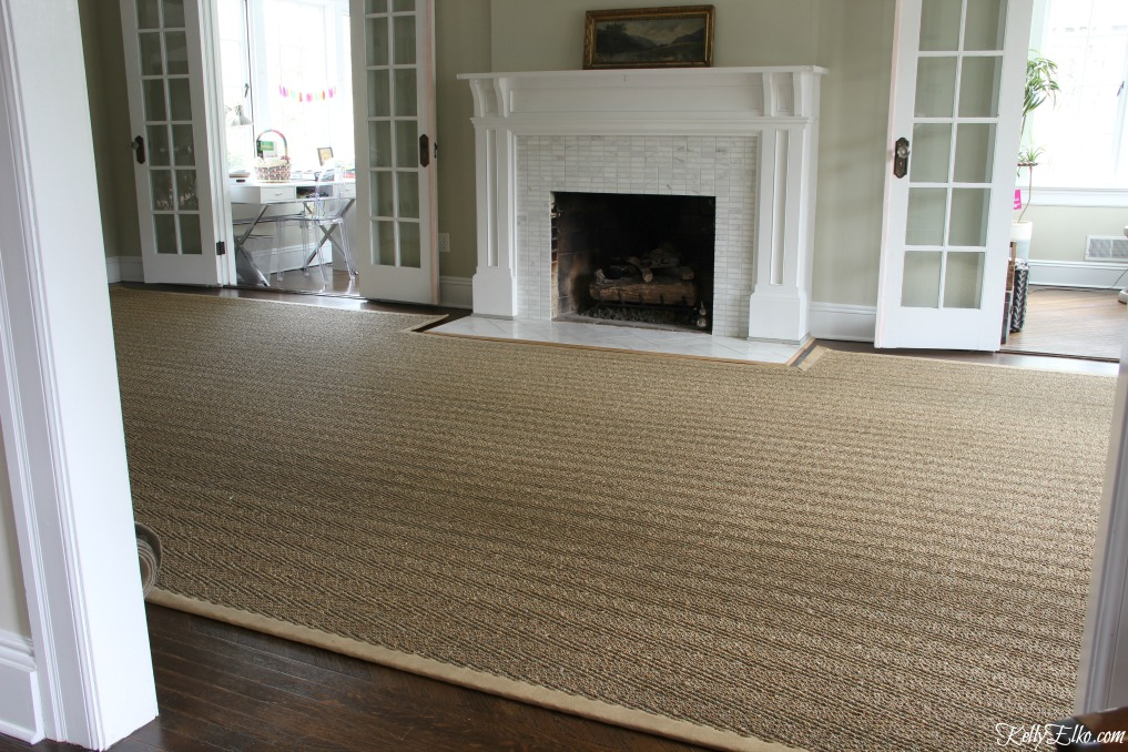 Custom sisal rug is cut to fit around a fireplace hearth and is perfect for oddly shaped rooms kellyelko.com
