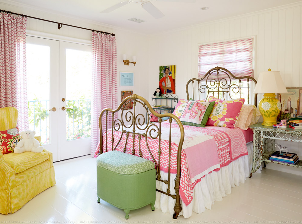 Colorful girls bedroom with vintage brass bed