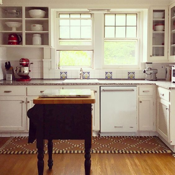 Country cottage kitchen with black butcher block island kellyelko.com