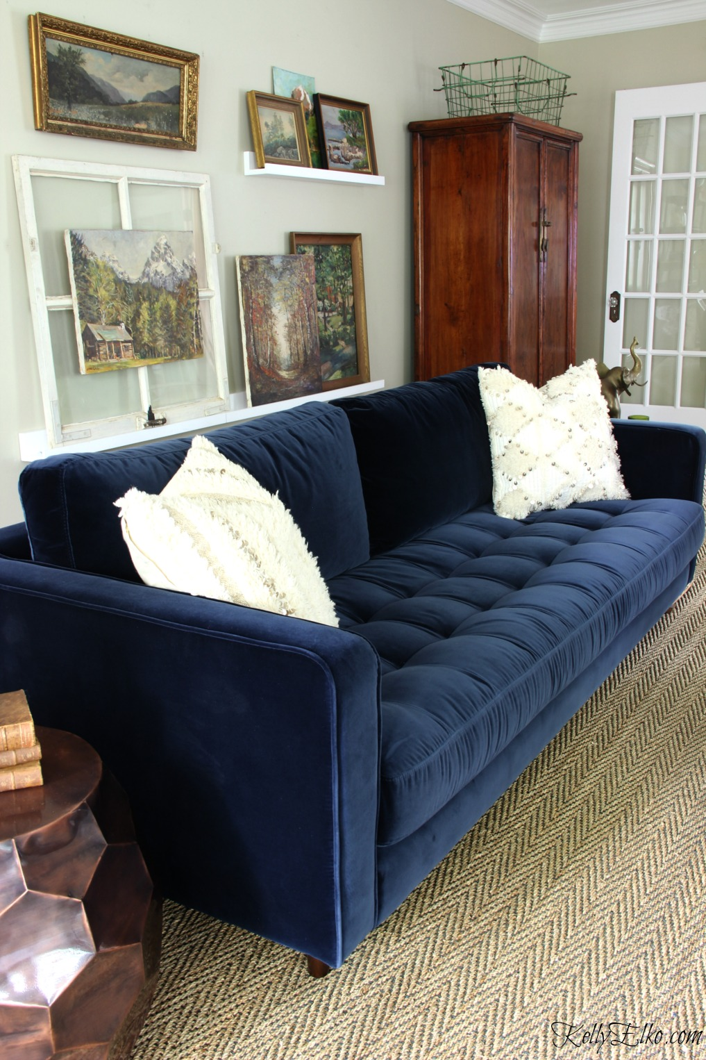 Love this blue velvet sofa with mid century style kellyelko.com