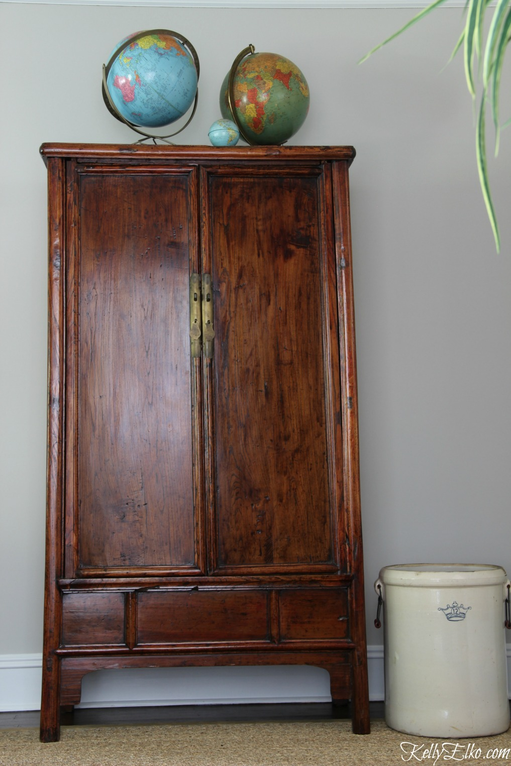 Asian armoire with vintage globes kellyelko.com