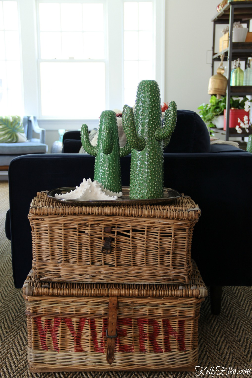 Stacked baskets make a unique side table and the cactus vases are so much fun kellyelko.com