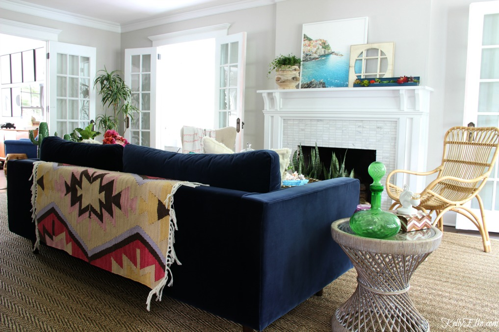 Colorful living room - love the blue velvet sofa with rug thrown over back for more color and texture kellyelko.com