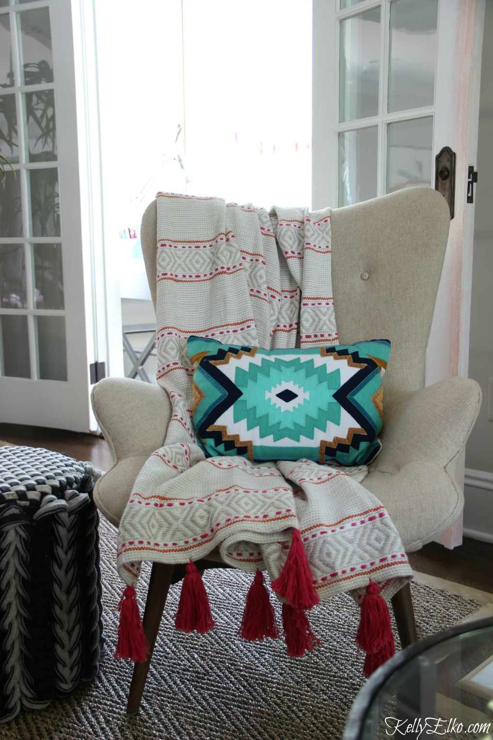 Love this mid century style chair with colorful pink tassel throw kellyelko.com