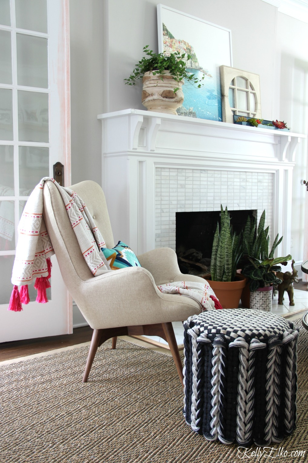Love this teddy bear chair with tassel throw and braided wool ottoman kellyelko.com