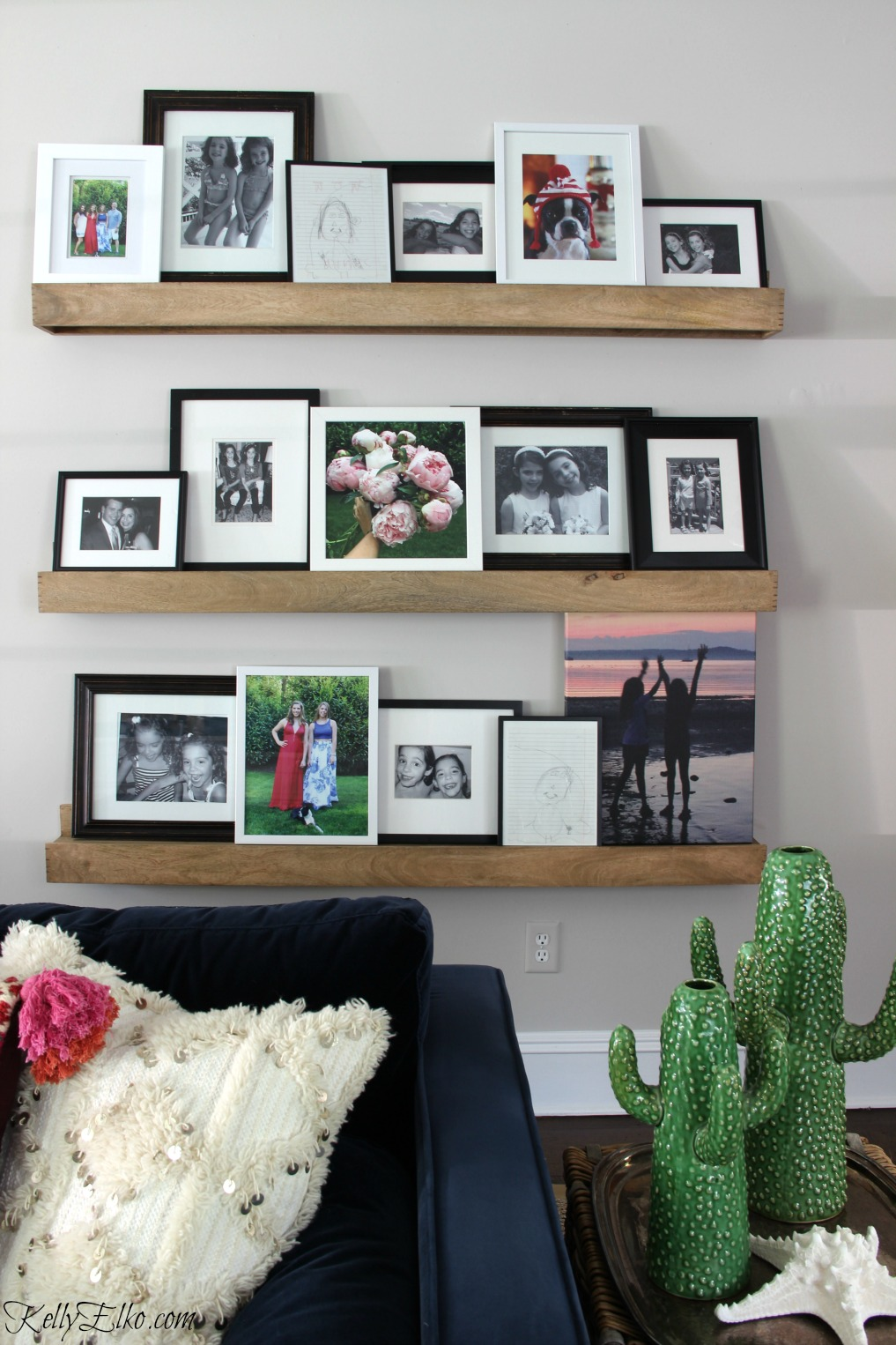 Love these warm wood picture ledges for a family photo gallery wall kellyelko.com