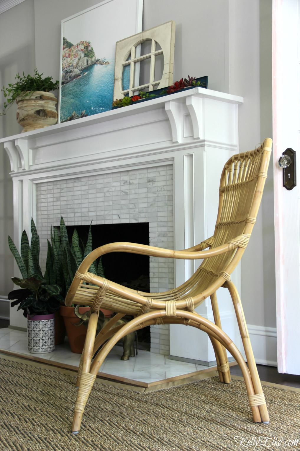 Love this outdoor rattan chair indoors - adds so much texture and a casual feel to the room kellyelko.com