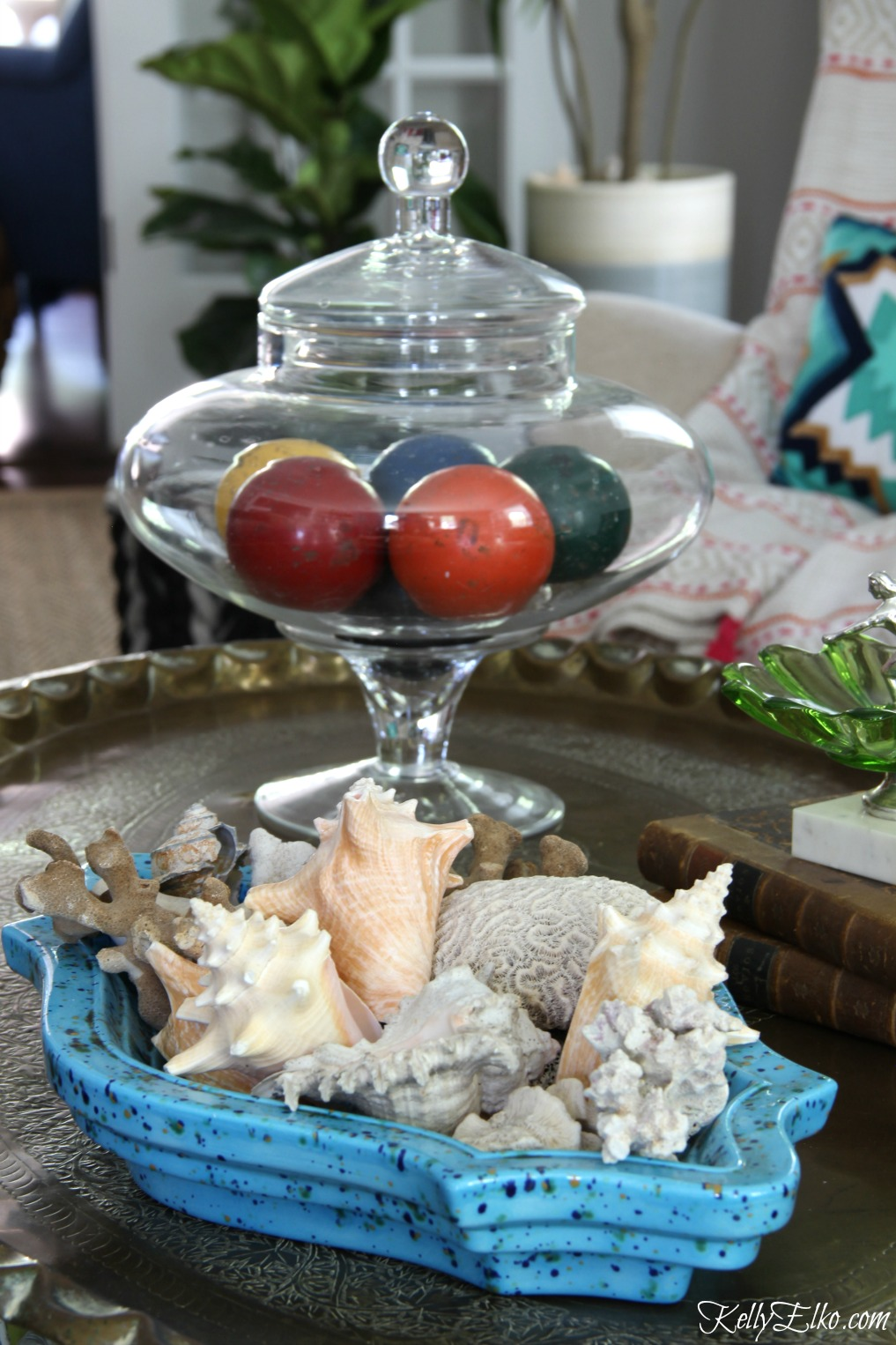 Vintage ashtray filled with shells and a jar of croquet balls makes a unique coffee table display kellyelko.com