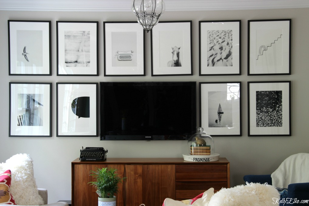 Love this black and white TV gallery wall to help camoflauge the television kellyelko.com