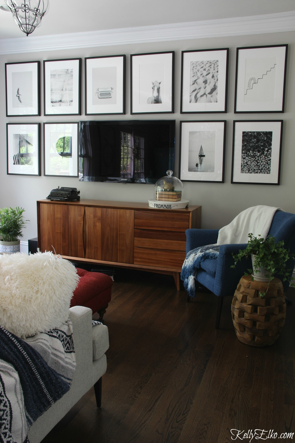 TV Gallery Wall - love the black and white art and mid century furniture kellyelko.com