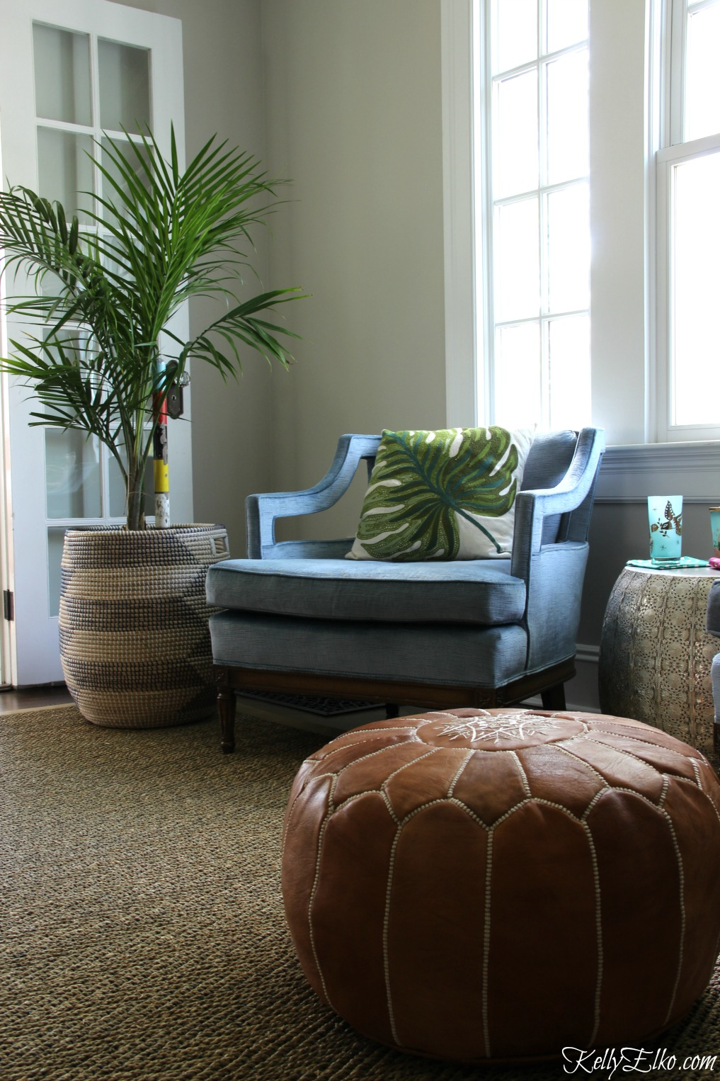 Love the palm tree in a basket paired with club chairs and a leather pouf kellyelko.com
