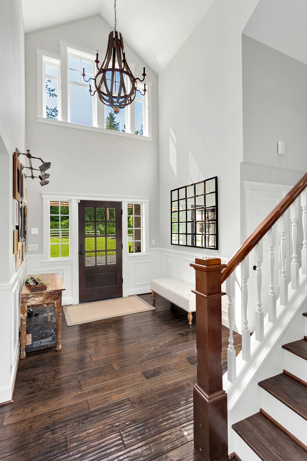 Dramatic two story foyer - love the chandelier kellyelko.com
