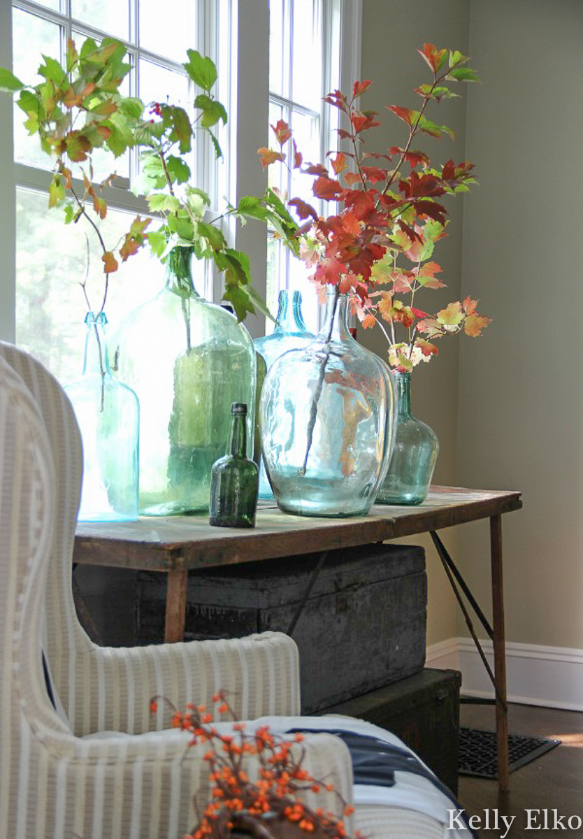 Love these vintage demijohns filled with fall branches kellyelko.com
