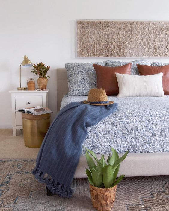Neutral bedroom with paper cut art and touches of blue kellyelko.com