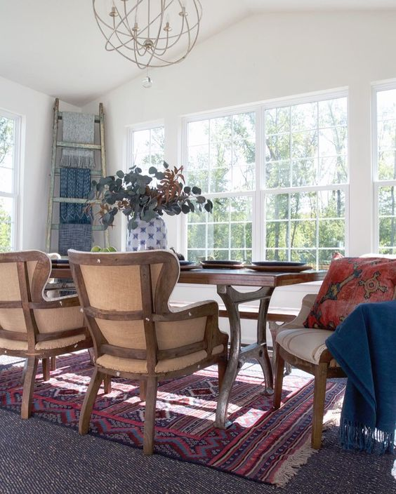 Love the layered rugs and deconstructed dining room chairs kellyelko.com