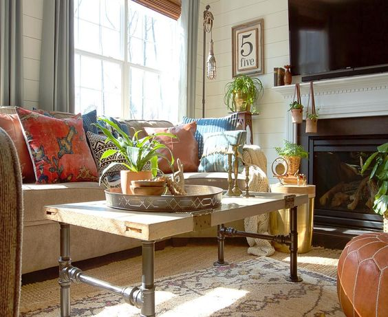 Love the mix of colorful pillows in this family room kellyelko.com
