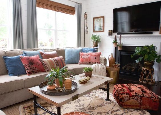 Colorful, boho family room with tribal rug and pouf kellyelko.com