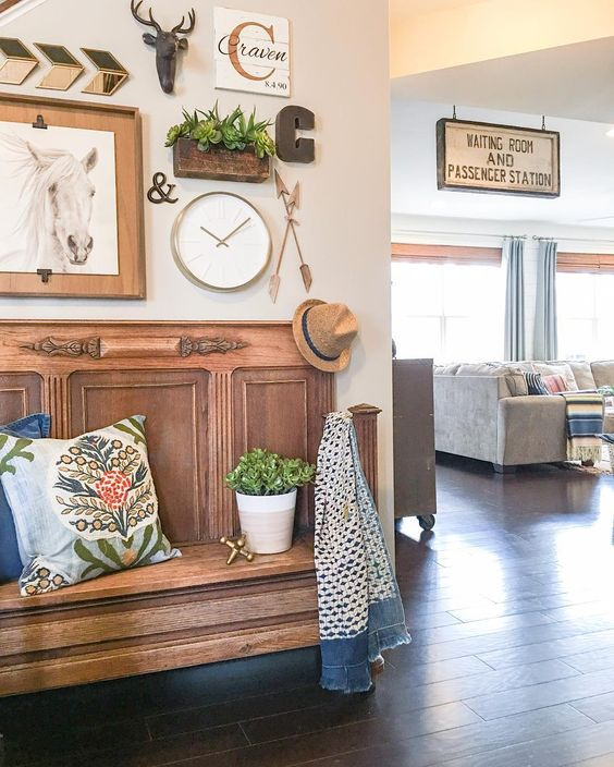 Eclectic home tour of Louisa Craven - love the warm wood bench and old sign kellyelko.com