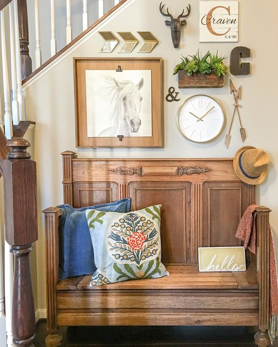 Love this bench that looks like an old church pew and the gallery wall above kellyelko.com