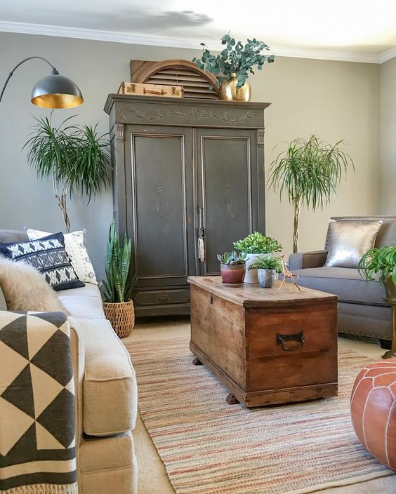 A black armoire is the focal point in this cozy living room kellyelko.com