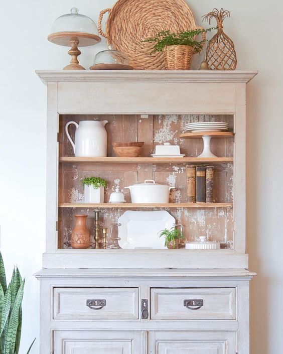Painted hutch with weathered interior shows off vintage collections kellyelko.com