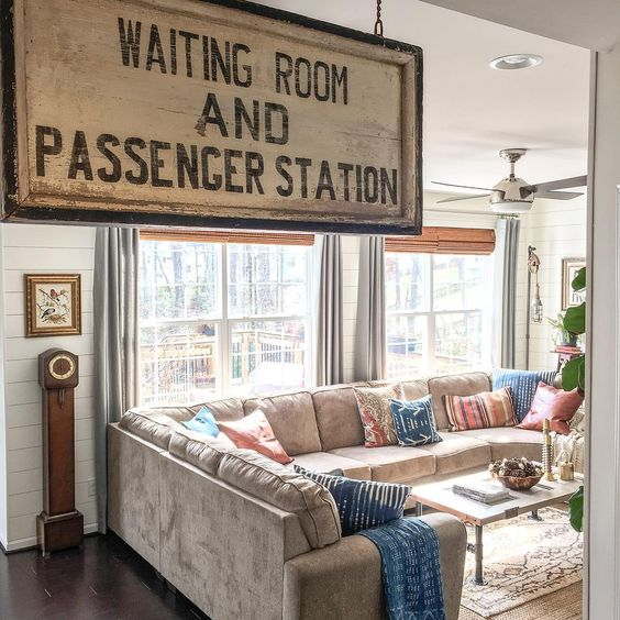 An old sign adds personality to this cozy family room kellyelko.com
