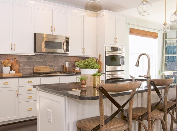 White kitchen with black counters and warm wood bar stools kellyelko.com