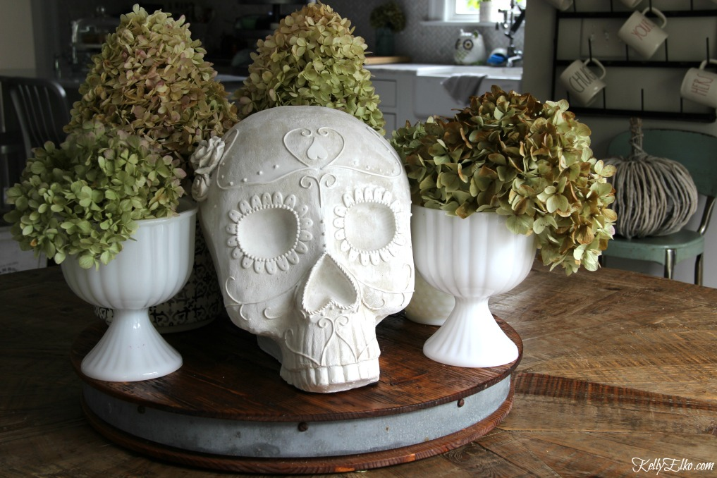 Love this sugar skull surrounded by dried hydrangeas for a quick and unique centerpiece kellyelko.com