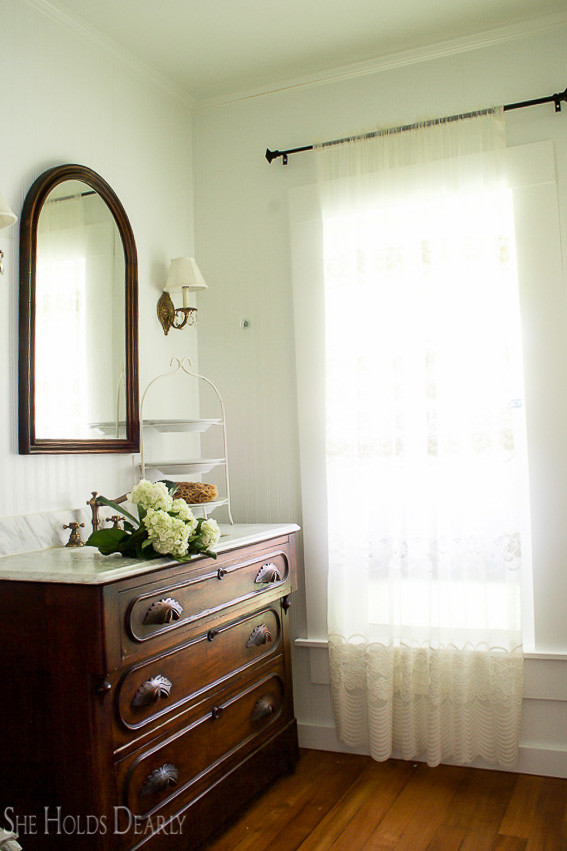 Farmhouse tour - love the antique dresser turned bathroom vanity