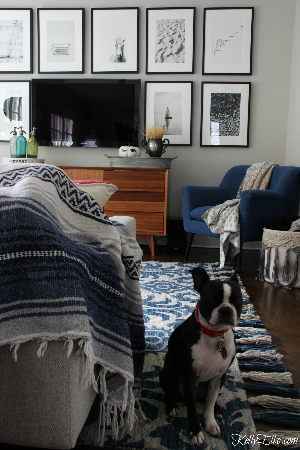 Love this family room with blue Loloi tassel rug and beautiful tv gallery wall kellyelko.com