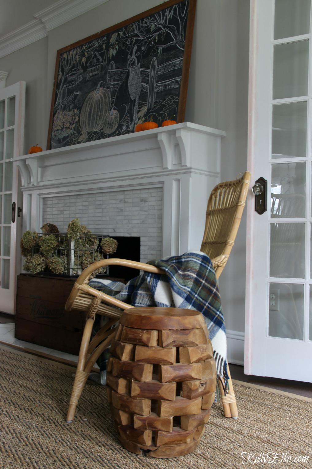 Eclectic living room with wicker, wood and sisal and a giant chalkboard kellyelko.com