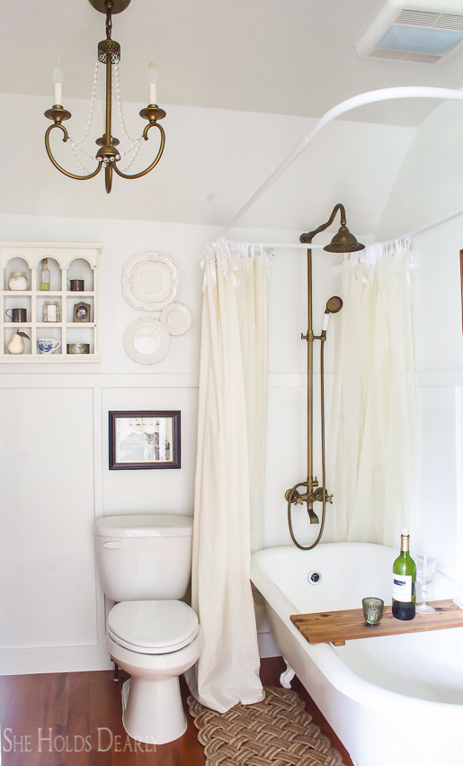 Farmhouse tour - love the antique clawfoot bathtub and brass fixtures