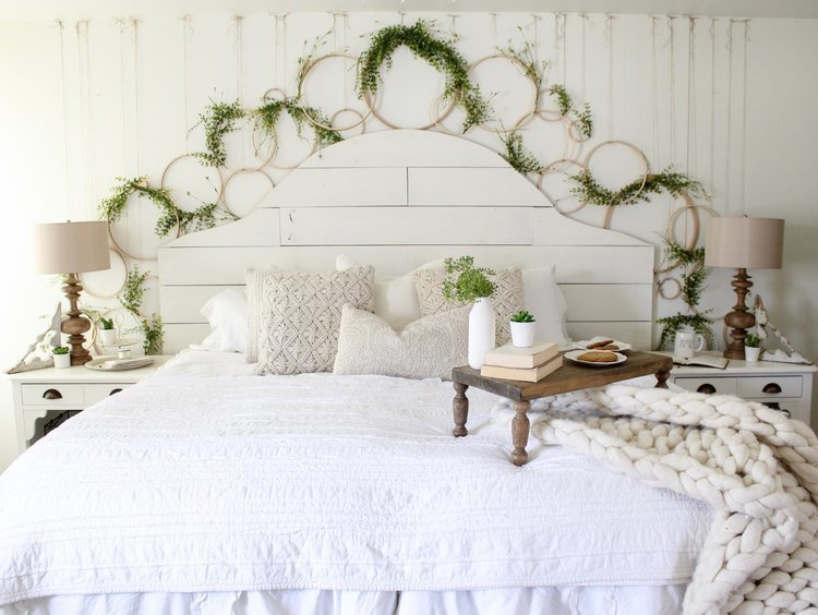 Farmhouse tour - love this wall of embroidery hoop wreaths over the bed