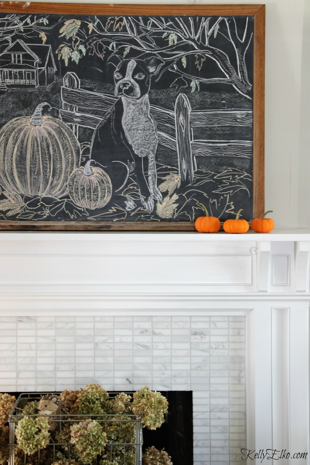 Love this fall chalkboard art mantel in this eclectic fall living room kellyelko.com